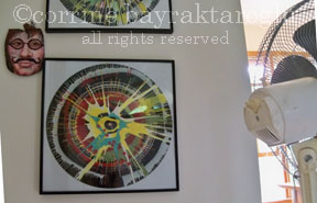 Corrine Barak's Spin Art hanging on the wall of her home