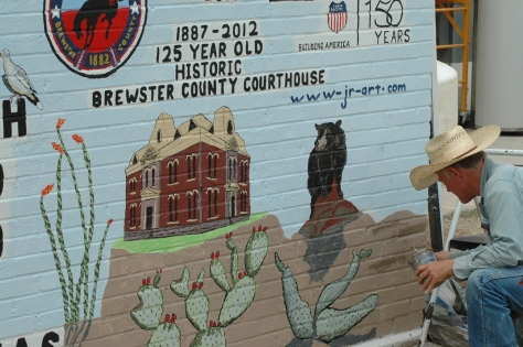Artist J.R. Smith at work on mural.