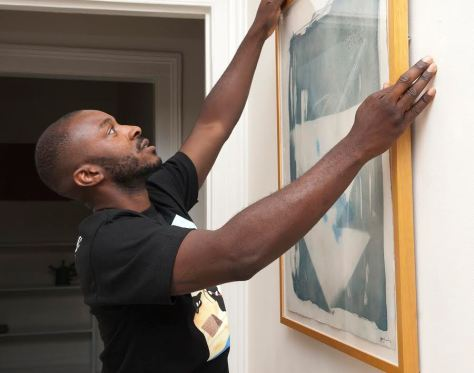 "Yves Wilson installing his Cyanotype in the exhibition gallery space of the ""PLACE // functional design & photography"" show"