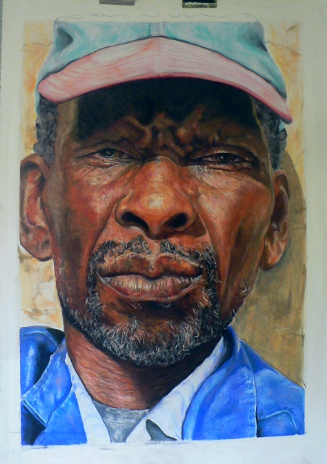 "Lynette Swanepoel's pastel portrait of ""The Old man with cap. He is a introvert and one can see in the way he almost does not allow you to see into his eyes. He is a cattle herder and looks after all the cattle on the farm."""