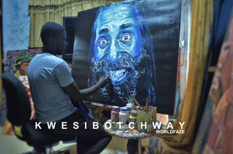 Kwesi Botchway at work on his painting titled The Joker