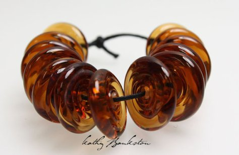 Brown disc lampwork beads created by Kathy Bankston